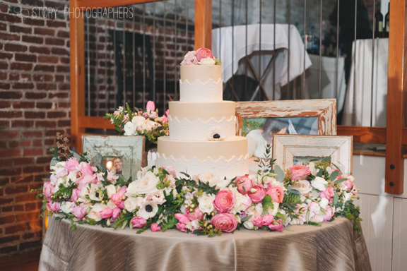 Wedding Cake Table with Flowers and Photos