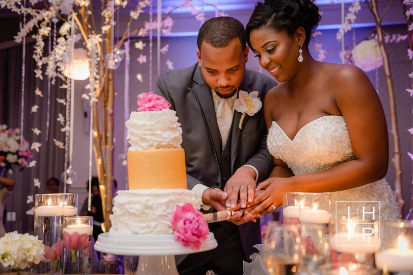 North Carolina couple cuts the cake at Hotel in Raleigh