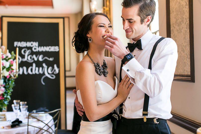 Bride and groom share wedding cake