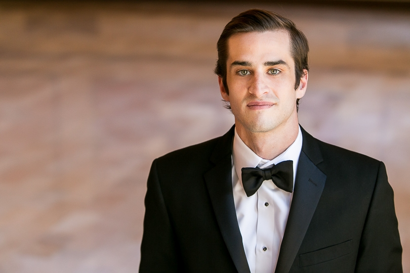 Raleigh groom in a classic black tuxedo