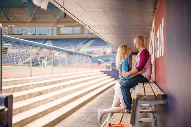 Couple's engagement session in baseball park