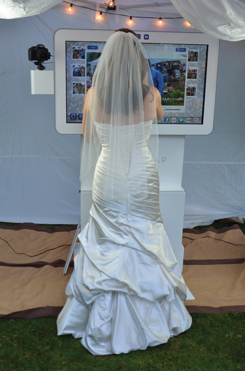 Raleigh bride sharing photo booth pictures on social media