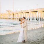 OBX NC wedding venue Bride and Groom Kiss at Jennettes Pier D'Ambra