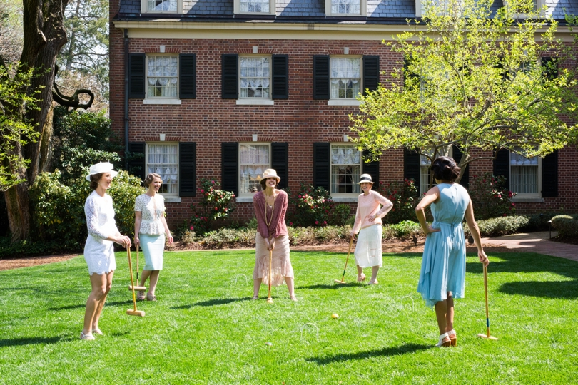 Bridesmaids play a game of croquet at The Carolina Inn