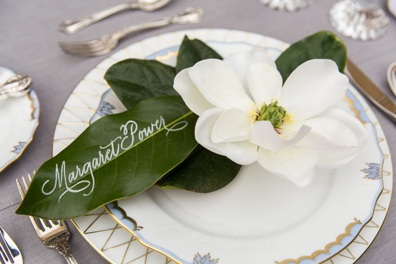 Calligraphy on flower leaves for wedding tables
