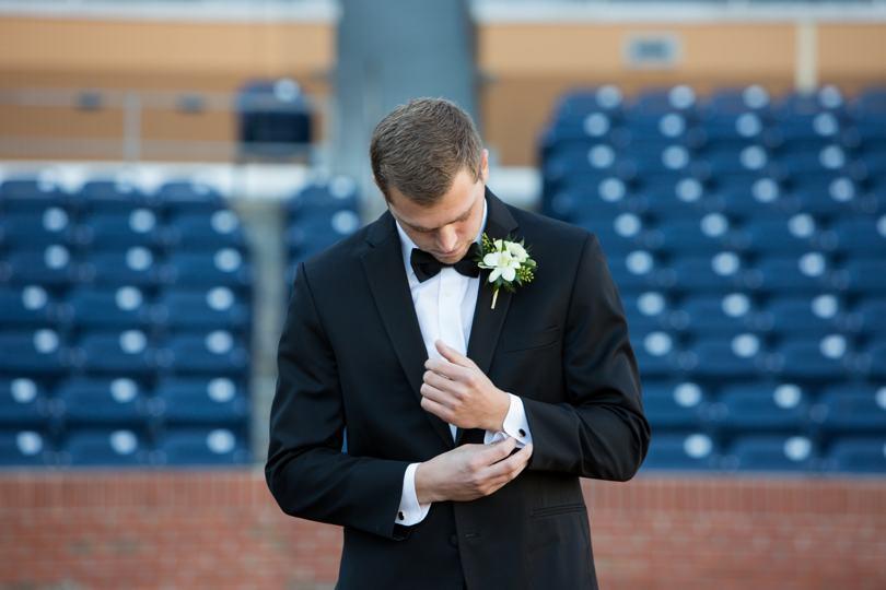 Durham NC groom at Durham Bulls Park