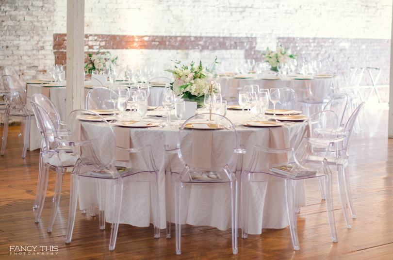 Ghost chairs and white linen for wedding