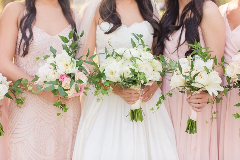 Bouquets in hands with blush gowns by Jamie Blow Photography
