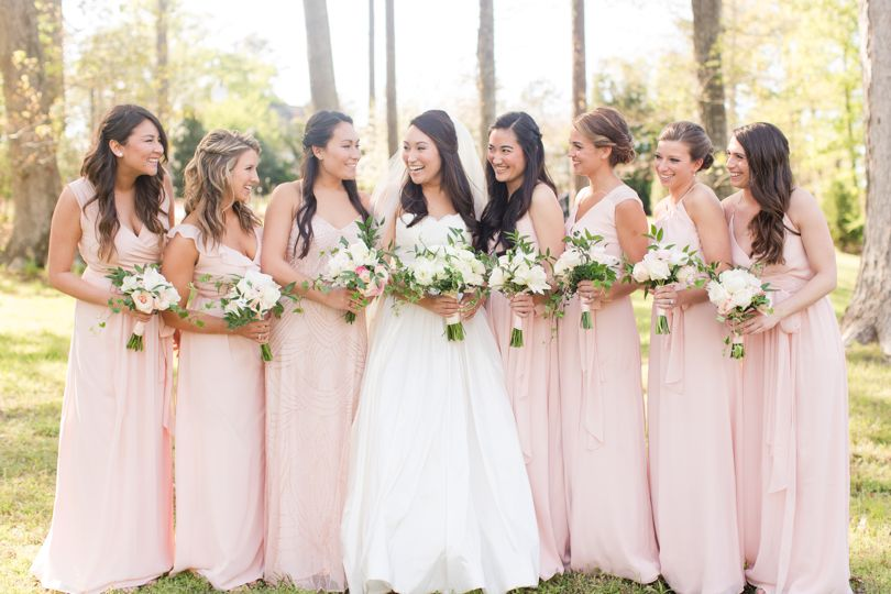 Bride and mix and match Bridesmaids in Pink Adrianna Papell and Joanna August dresses Jamie Blow Photography