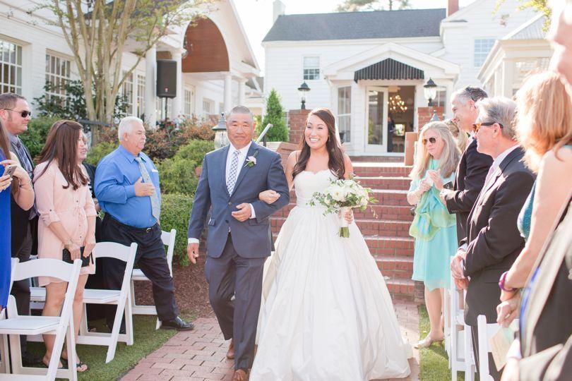 Father walking bride down aisle at Highgrove Estate wedding