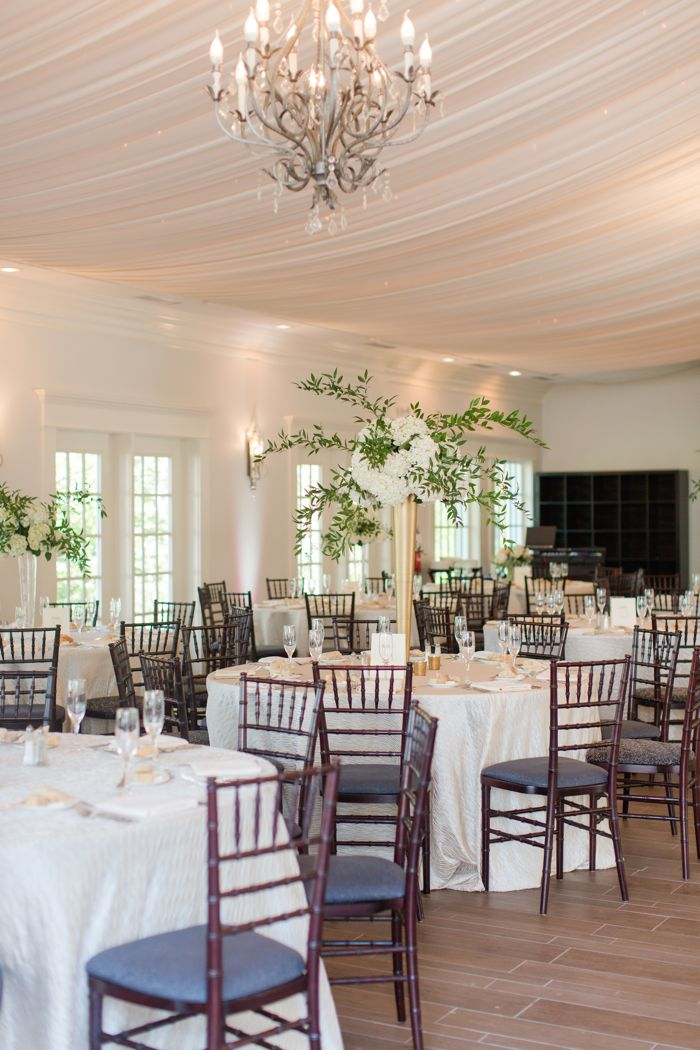 Highgrove Estate Wedding Reception with Tall Floral Arrangements Photo by Jamie Blow
