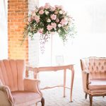 Lounge Area with Vintage Furniture and Elegant Pink Flowers La Cosa Bella Southern Love Studios