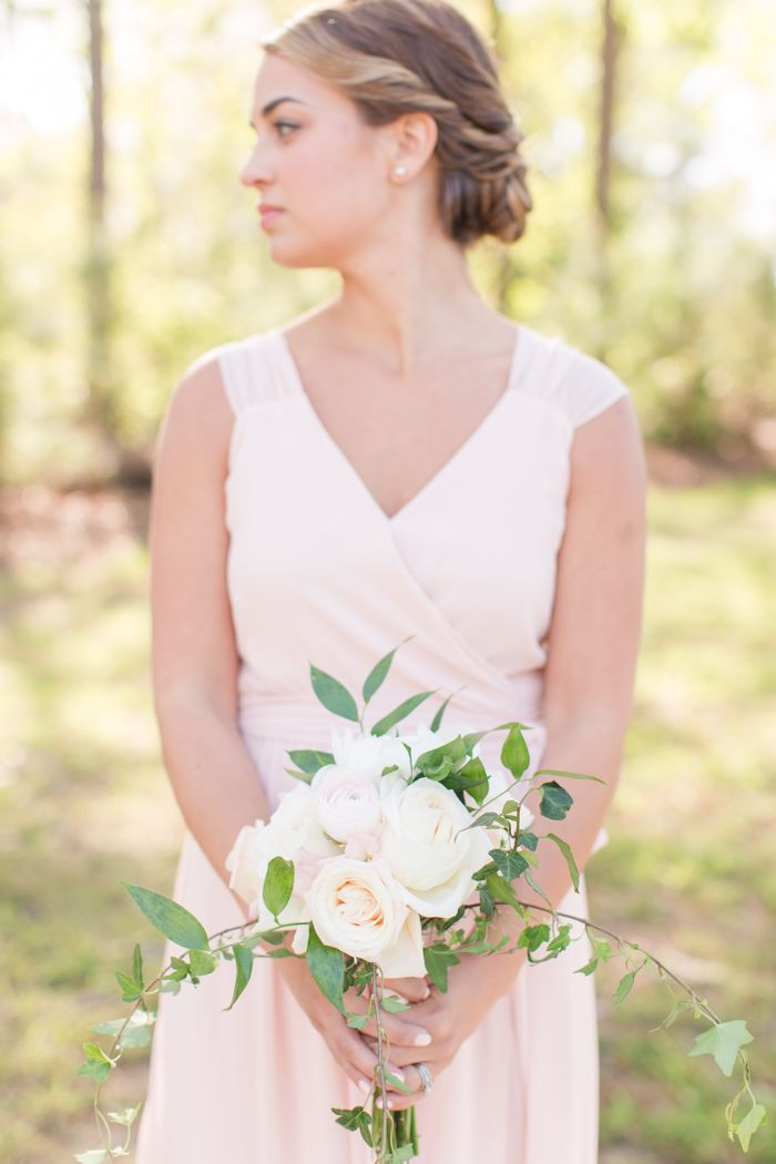 Pink Joanna August gown from Bella Bridesmaid Raleigh with loose feminine bouquet