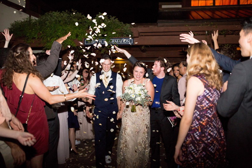 Bride and Groom exit under confetti at Duke Gardens Reception by Gather Together photographed by Katherine Miles Jones
