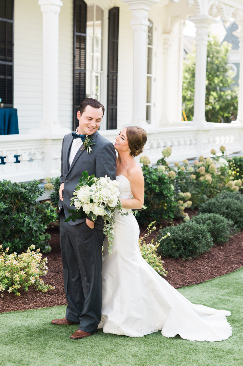 Bride and groom embrace in wedding must have photo at The Merrimon Wynne by Gather Together, Melissa Delorme