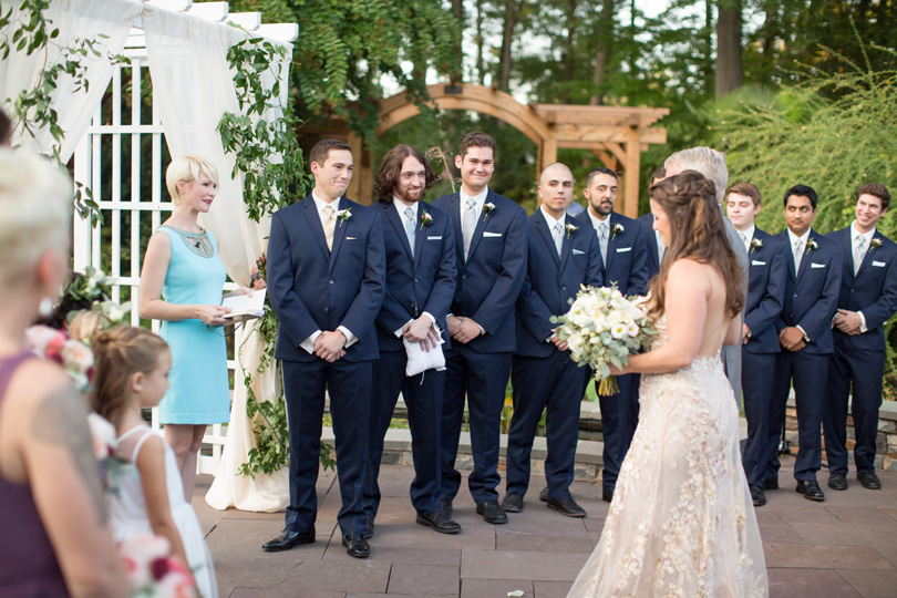 Bride walking down aisle at NC outdoor ceremony with groom smiling Duke Gardens wedding by Gather Together Photography by Katherine Miles Jones