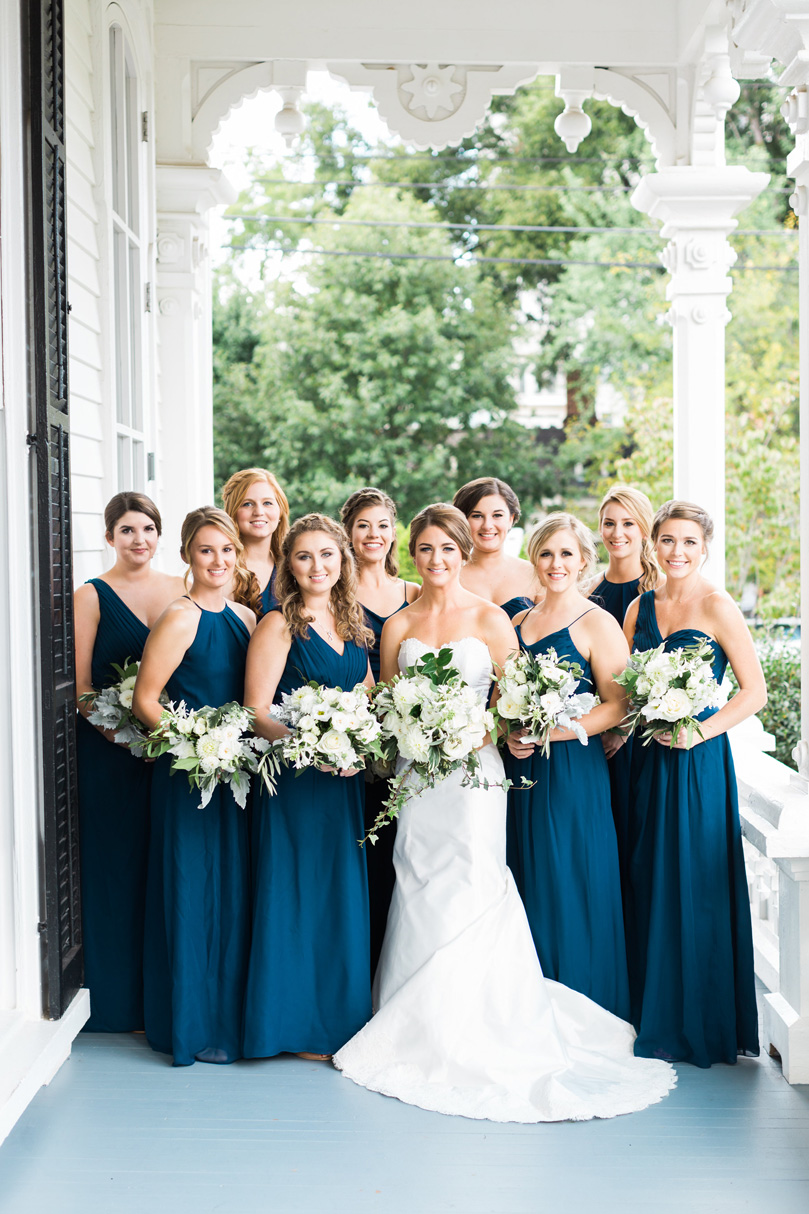 Bridesmaids in Navy and Bride on porch at The Merrimon Wynne by Gather Together, Melissa Delorme