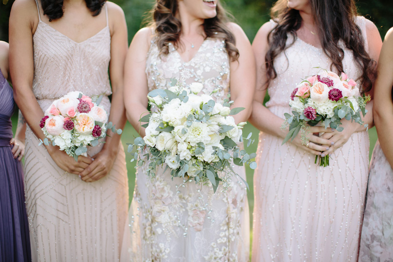Bridesmaids in mismatched BHLDN pastel dresses and bride in Patricia Bonaldi embellished dress with florals from Watered Garden at Duke Gardens by NC Photographer Katherine Miles Jones