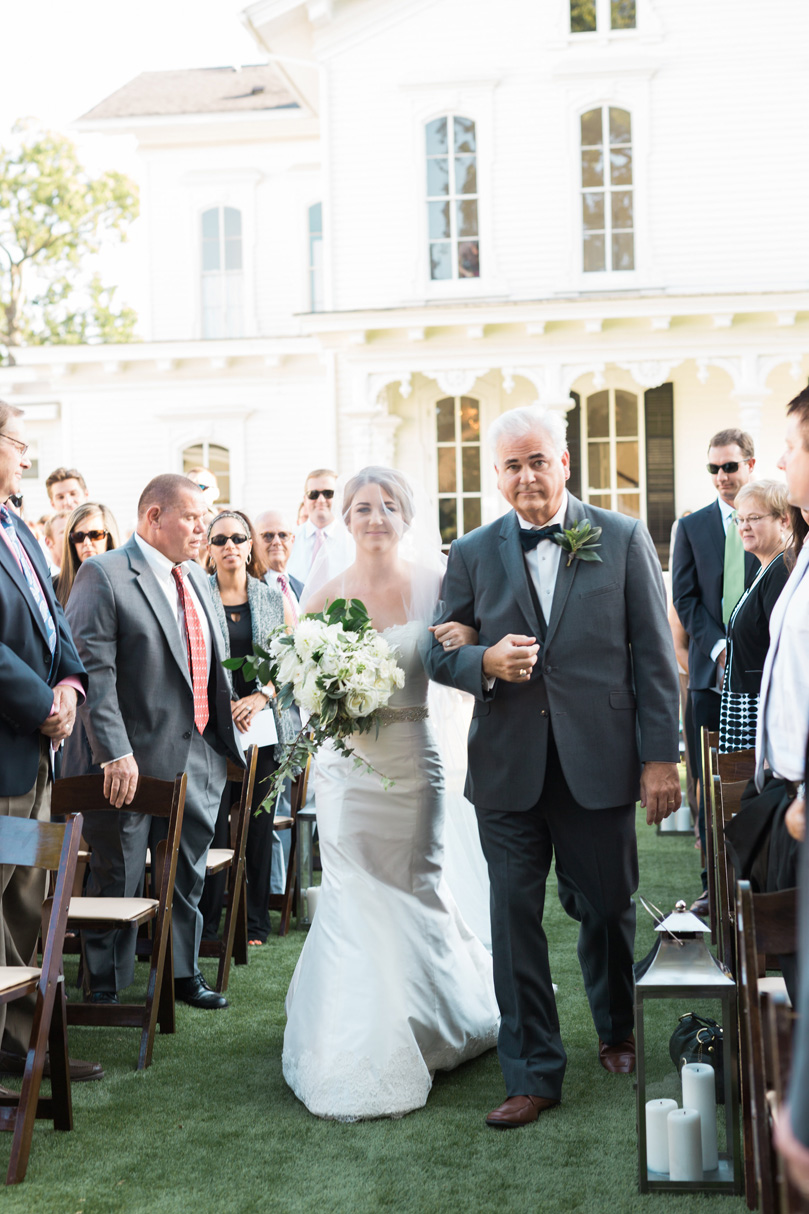 Father of Bride walking bride down the aisle with veil during outdoor ceremony at The Merrimon Wynne by Gather Together, Melissa Delorme