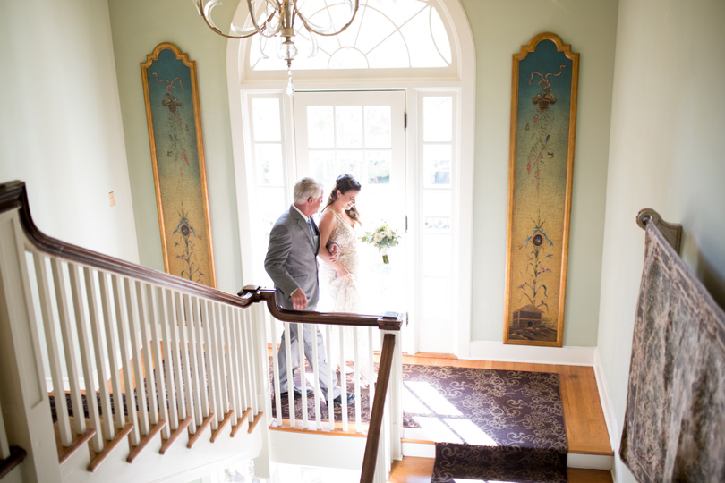Father of the bride and bride walking down staircase at Duke Gardens wedding by Gather Together Photography by Katherine Miles Jones