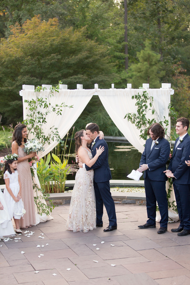 First Kiss at Duke Gardens wedding by Gather Together Photography by Katherine Miles Jones