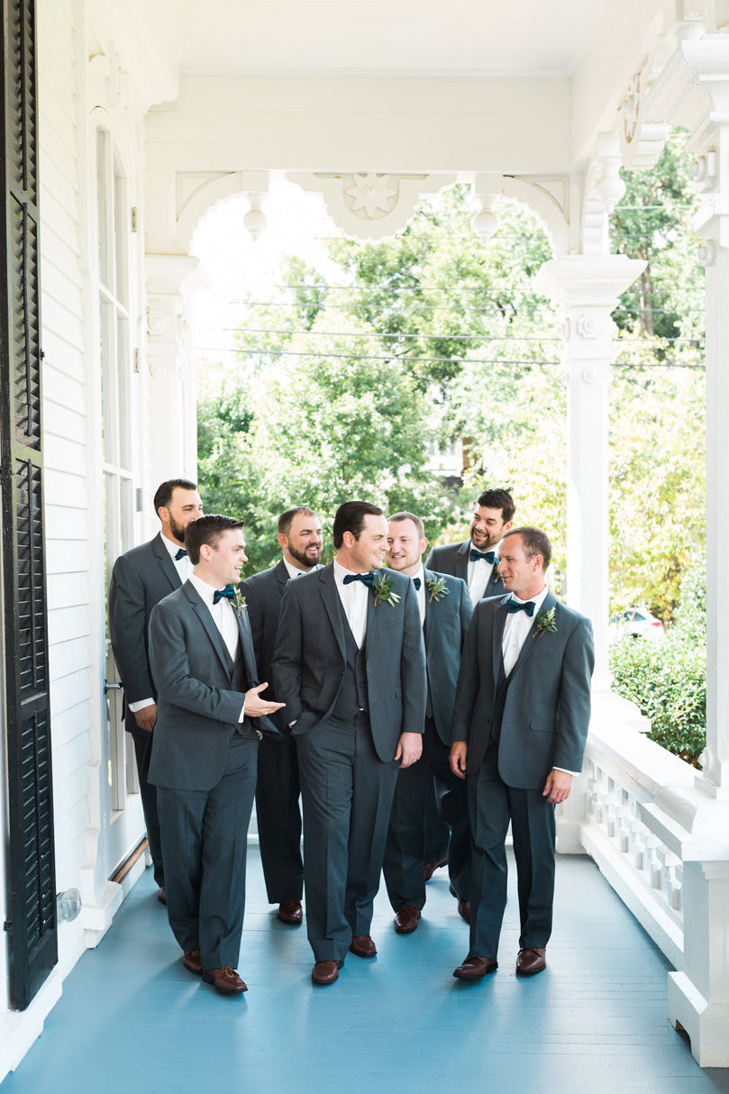 Groom and Groomsmen in classic dark grey suits by VIP Formal Ware and bowties at The Merrimon Wynne by Gather Together, Melissa Delorme