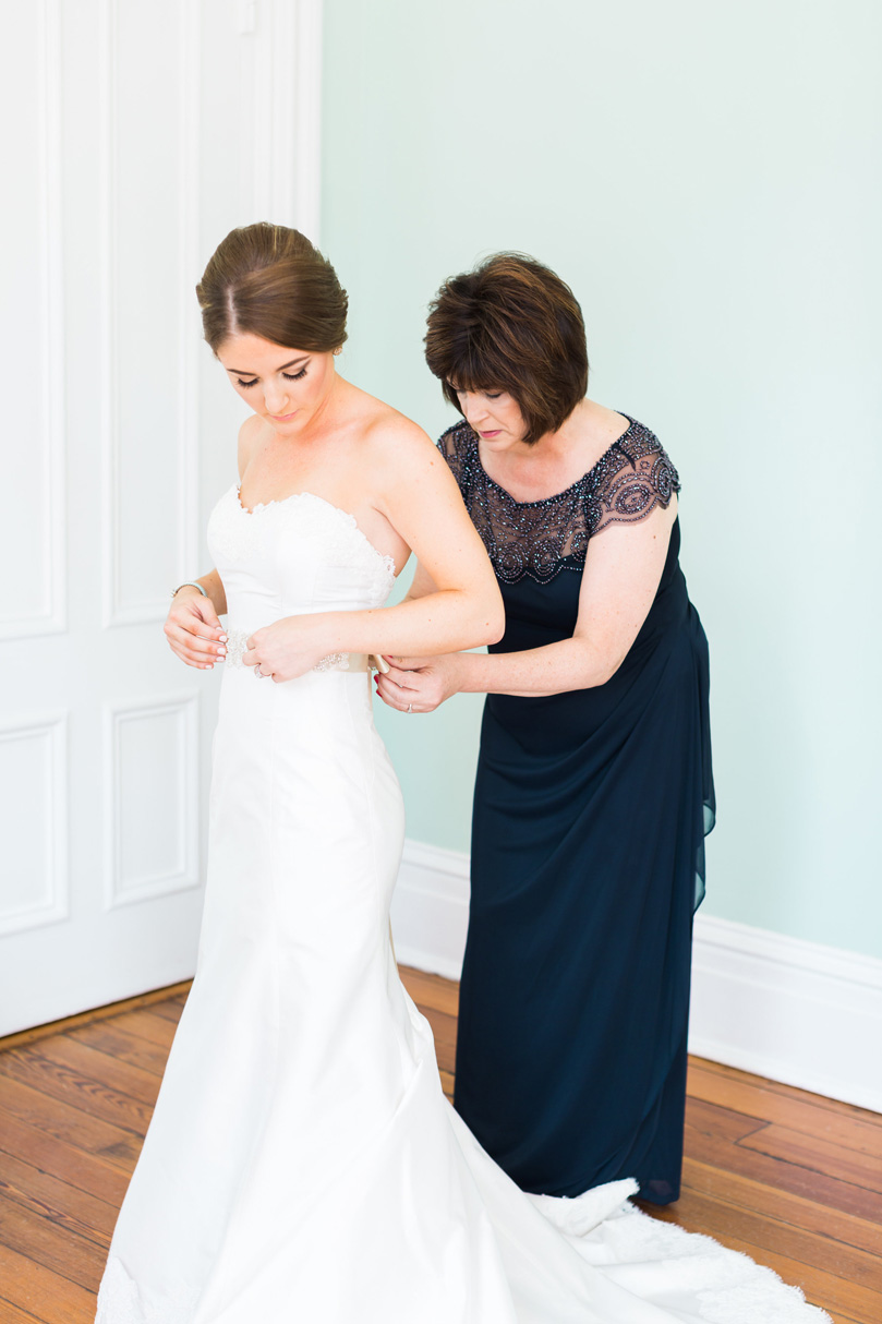Mother of Bride helping bride in Lea Ann Strapless down at The Merrimon Wynne House, Melissa Delorme