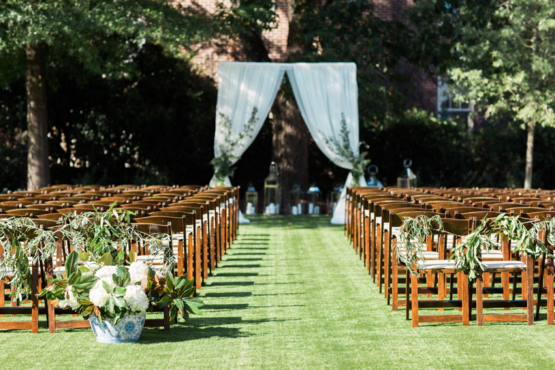 NC Outdoor wedding with wooden chairs and white drape arbor at The Merrimon Wynne by Gather Together, Melissa Delorme