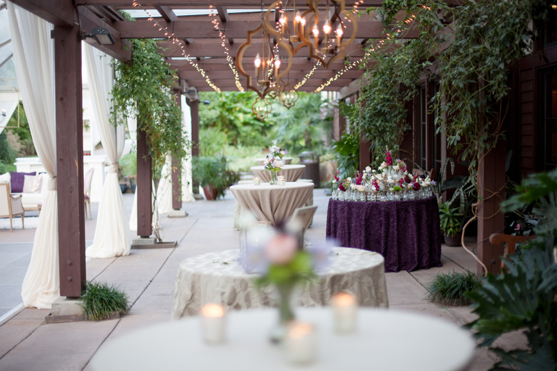 Romantic Outdoor Reception Cocktail rounds with Hanging lights and neutral linens Duke Gardens Reception by Gather Together photographed by Katherine Miles Jones