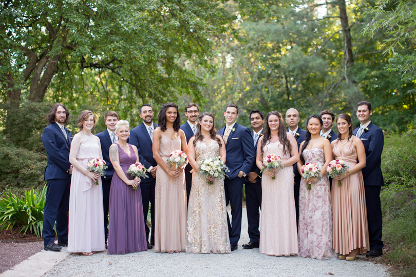 Wedding party in mismatched bridesmaids gowns and navy suits in NC Wedding at Duke Gardens wedding by Gather Together Photography by Katherine Miles Jones