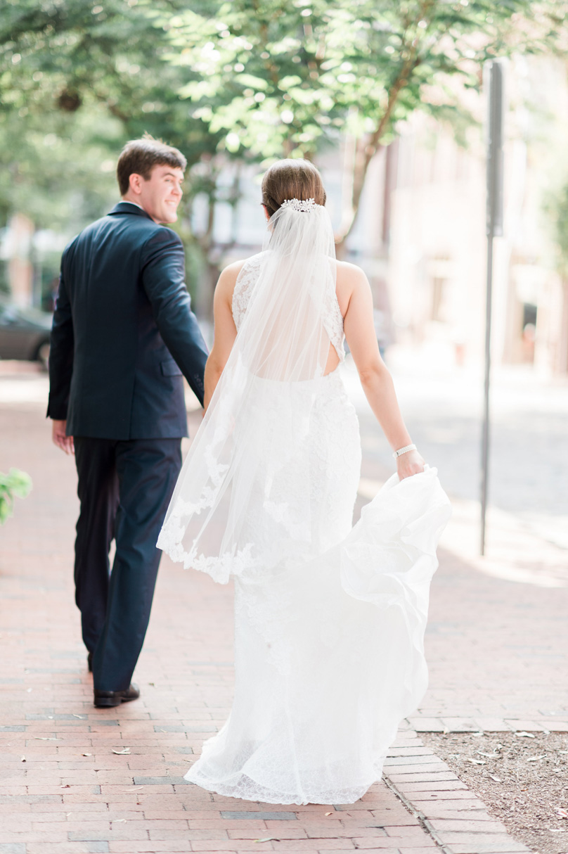Beautiful-photo-of-bride-and-groom-walking-away-in-downtown-raleigh-wedding-Missy-Loves-Jerry-Photography