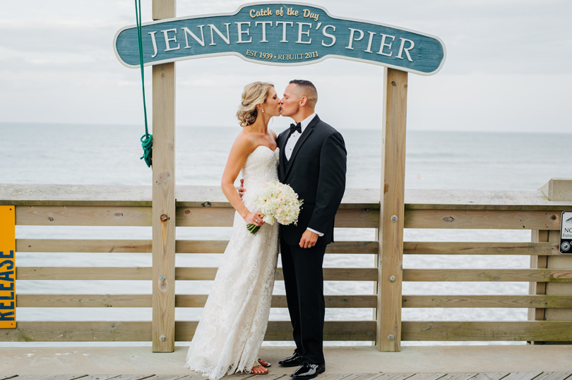 Bride and Groom kissing at Jennettes Pier