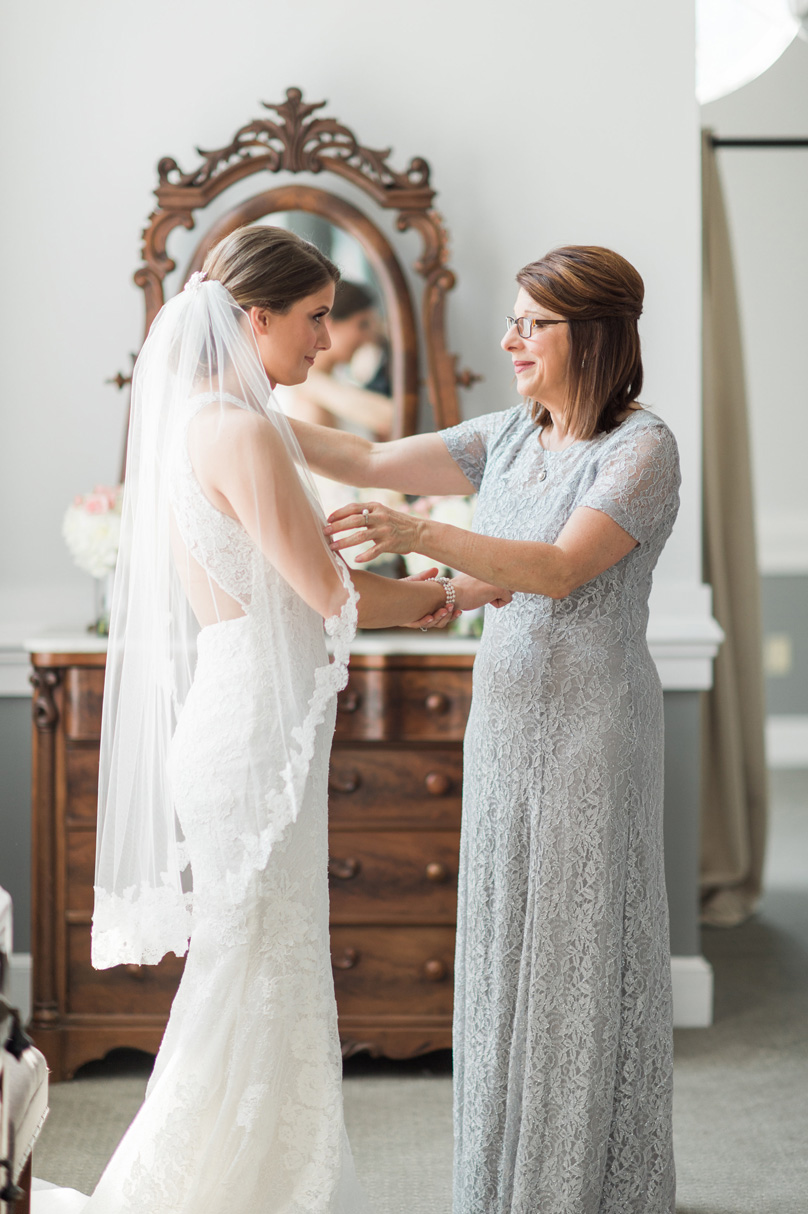 Bride and mother of bride intimate moment getting ready photo Missy Loves Jerry Photography