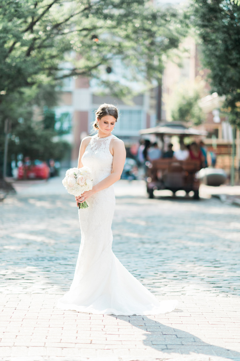 Bride in downtown raleigh at MArket hall Missy Loves Jerry Photography