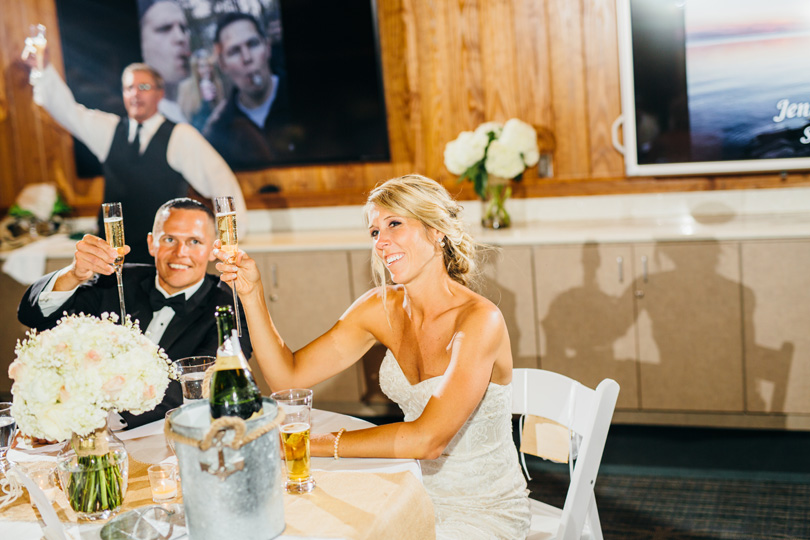Champagne toast for bride and groom at Jennettes Pier in Nags Head NC wedding photographer Sarah D'Ambra