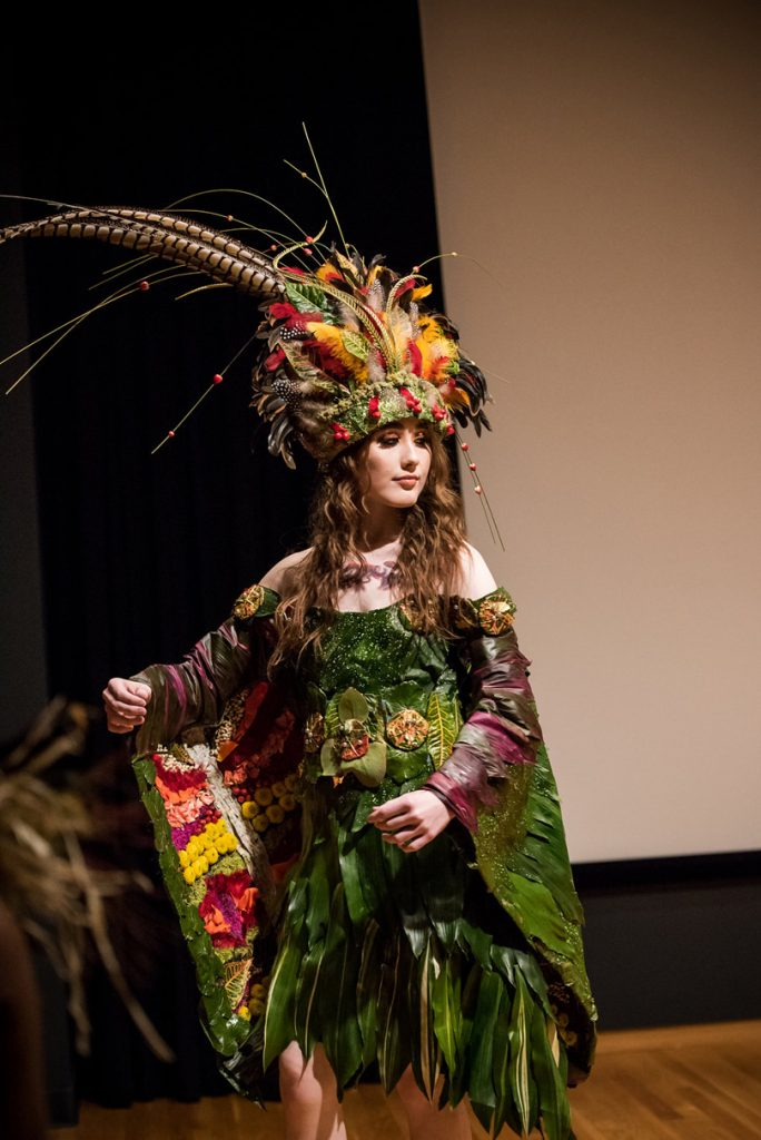 Intricate greenery dress and large headpiece at NCMA Art in Bloom fashion show f8 Photo Studios