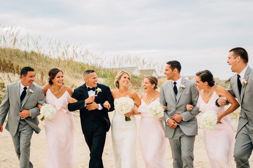 Laughing wedding party in NAgs Head wedding Sarah D'Ambra