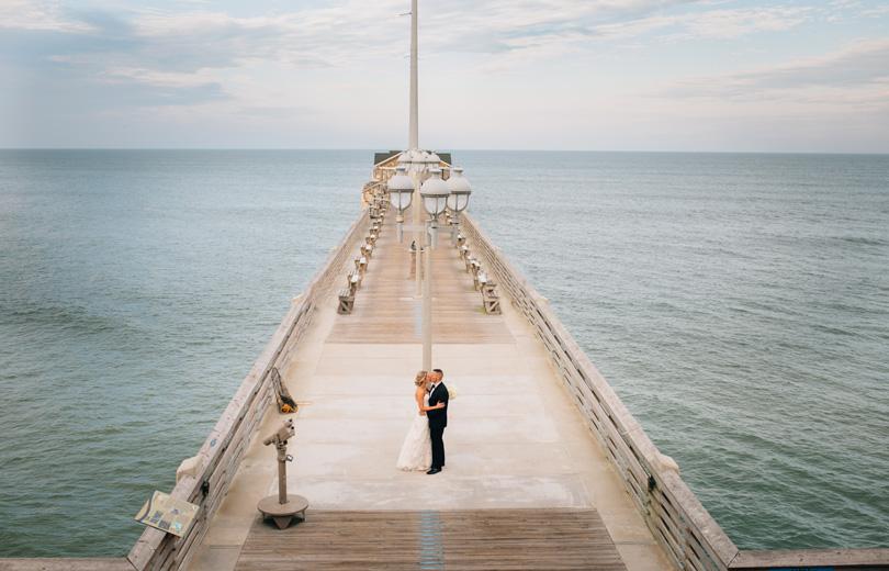 Nags Head NC Wedding Bride and Groom on Jennettes Pier NC Wedding photographer Sarah D'ambra