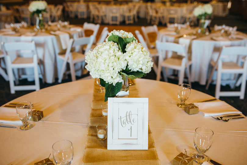 Wedding Table with White hydrangeas at Jennettes Pier in Nags head NC wedding photographer Sarah D'Ambra