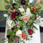 Bridal bouquet with dark reds and peaches by English Garden of Raleigh, KMJ