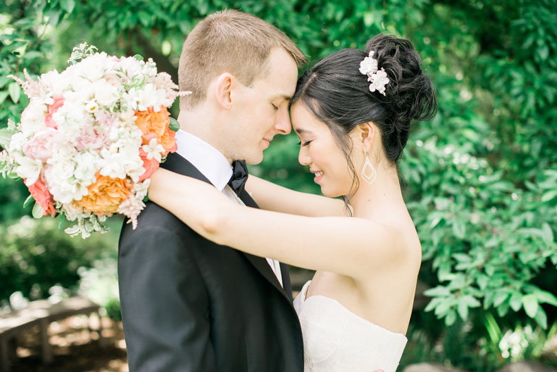 Bride and Groom Embrace at Duke Gardens with Tre Bella Bouquet Casey Rose_1