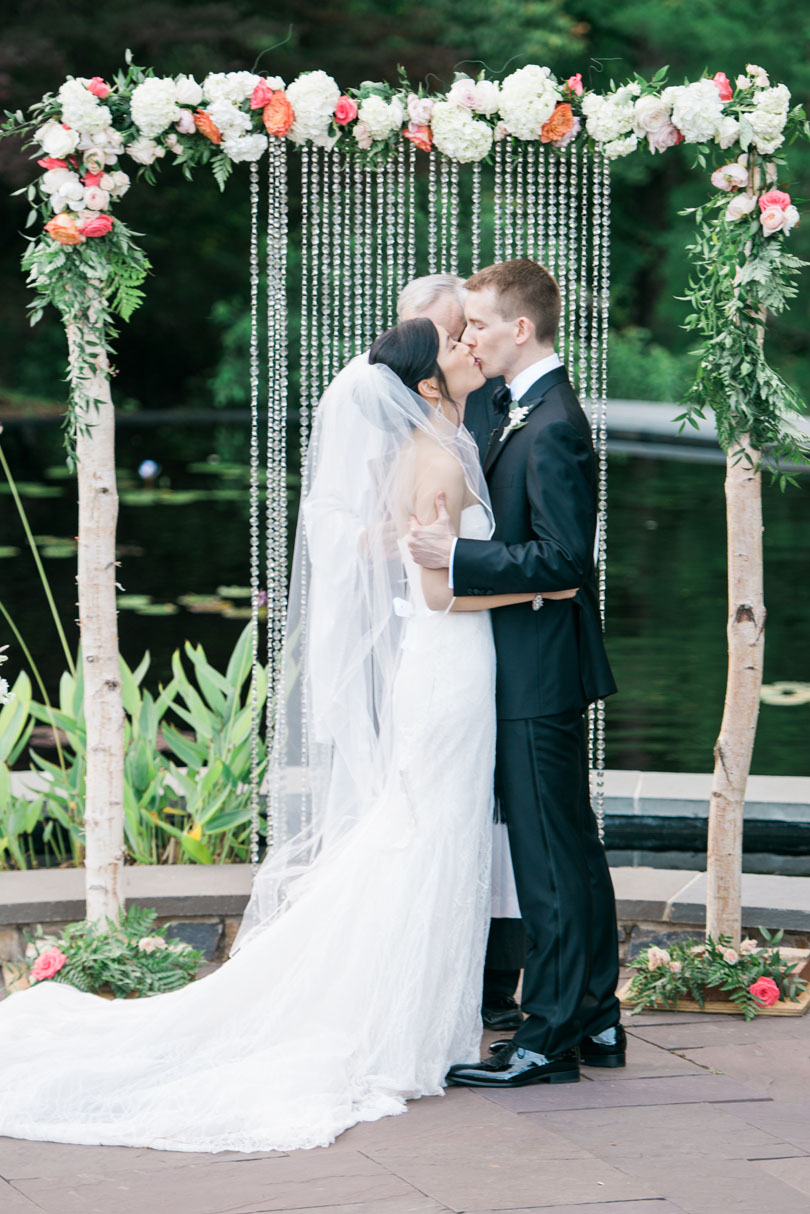 Bride and Groom First Kiss under Arbor at Duke Gardens Casey Rose_1