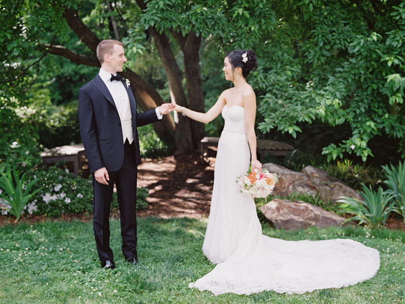 Bride and Groom hold hands at Duke Gardens Casey Rose_1