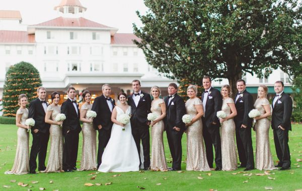 Bridal party in champagne gold and black tuxedos in front of venue at Pinehurst Resort, Mary Me