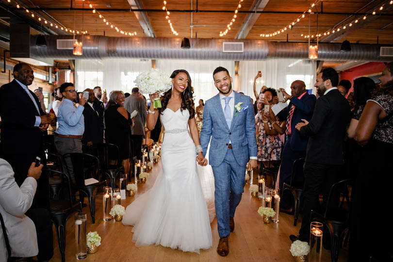 Bride and Groom walk down aisle after saying i do at Durham warehouse wedding venue, The Rickhouse, In His Image