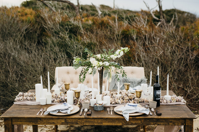 Winter Table inspiration with mixed candles, oyster shells, on obx beach, Sarah D'Ambra Photography