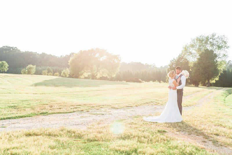 Rustic Romantic Wedding at The Rand-Bryan House, Bride-and-Groom-in-beautiful-wedding-photos-by-Raleigh-Durham-Wedding-Photographer-Bronwyn-Duffield.jpg