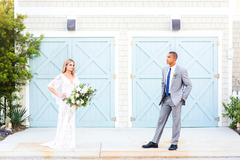 Bride and Groom in front of blue doors at Shoals Head for beach wedding Photography, Magnolia Photography