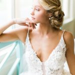 Bride-in-curled-updo-wearing-Eve-of-Milady-wedding-gown-from-The-Wedding-Dress-Shoppe-Photographed-at-The-Carolina-inn-by-Bronwyn-Duffield.jpg