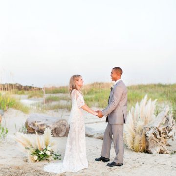 Bride and Groom embrace in beach wedding photography, Lion House, Magnolia Photography
